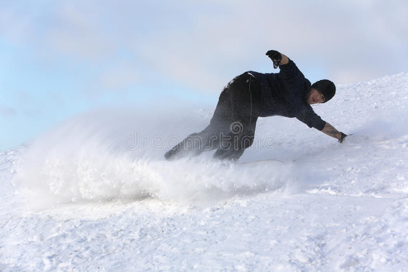 Young man on snowboard stock images