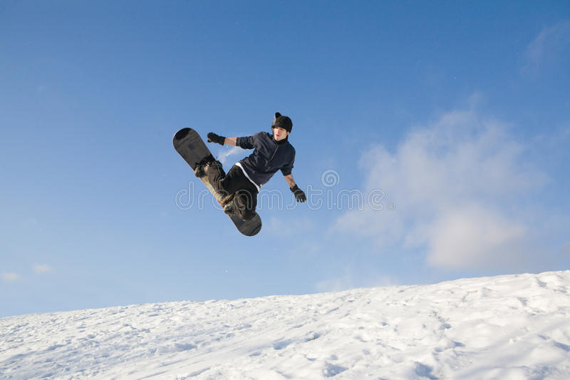 Young man on snowboard royalty free stock photo