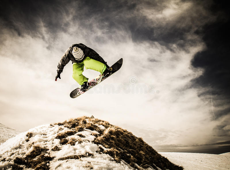 Young man snowboarder. Big air trick stock image