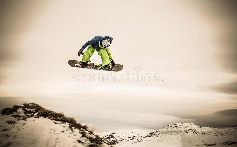 Young man snowboarder royalty free stock image