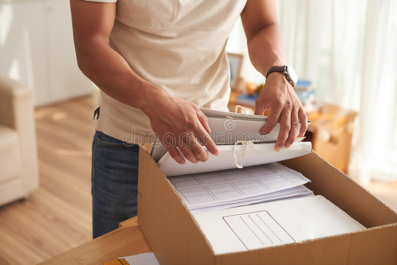 Young Man Sorting Box of Documents royalty free stock photo