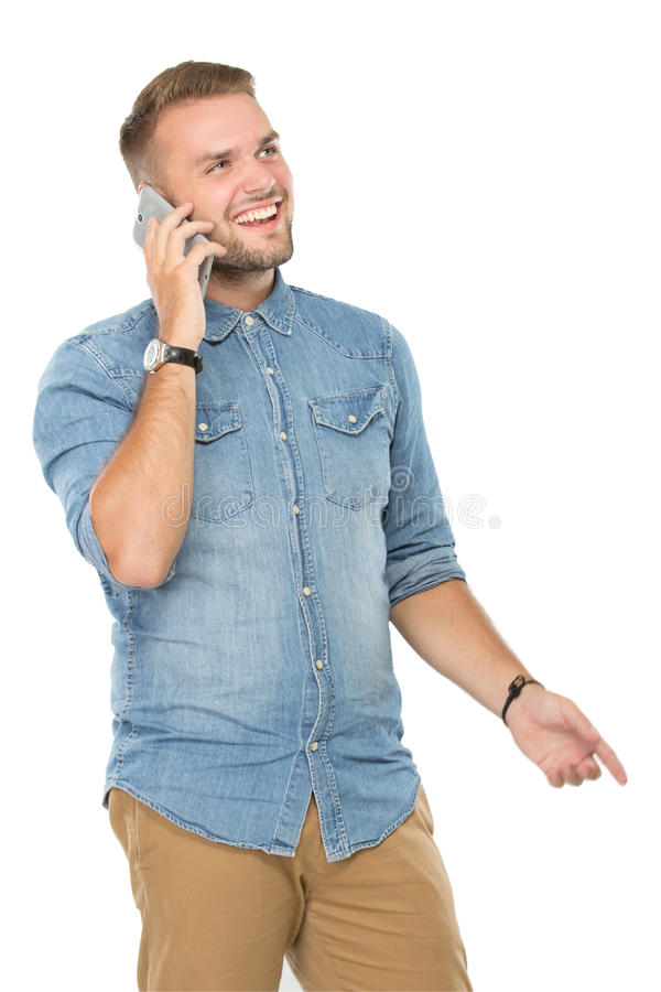 Young man speaking on his smartphone. A portrait of a young man speaking on his smartphone stock photography