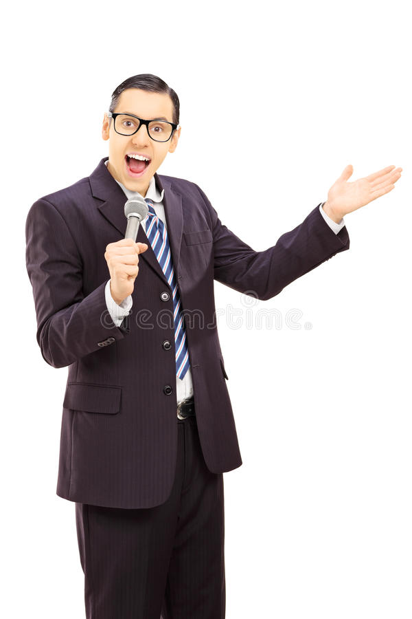 Download Young Man Speaking In A Microphone And Gesturing Stock Photo - Image: 37035044