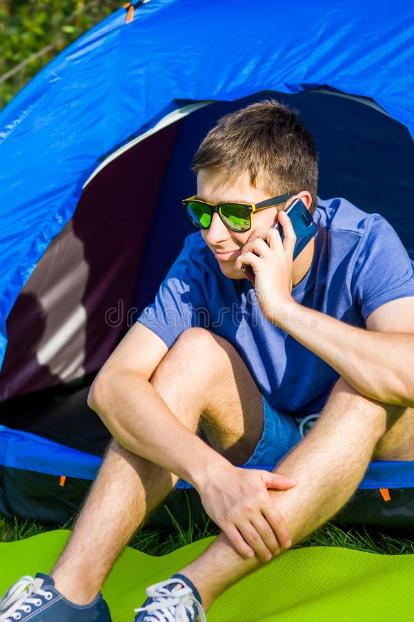 Young Man with a Phone stock photos