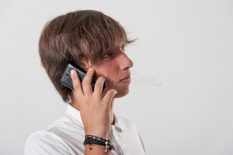 Young Man Speaks On The Phone Royalty Free Stock Photography