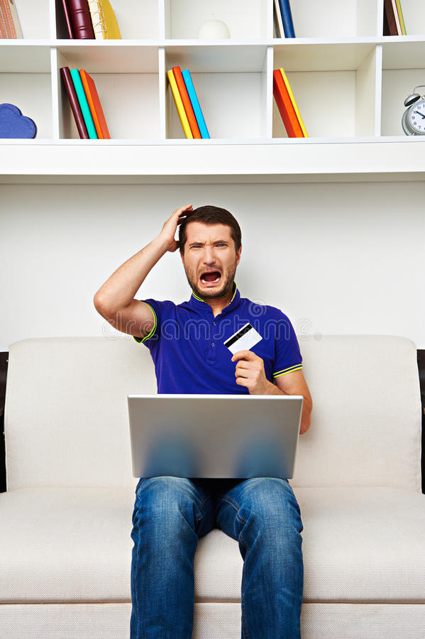 Young Man Spend All His Money In Internet Royalty Free Stock Images