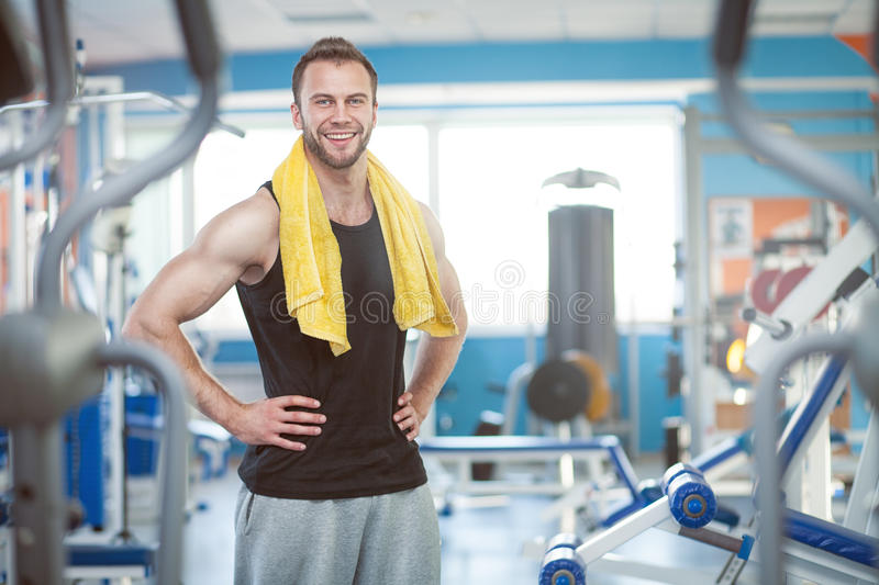 Young man in sport gym club stock image