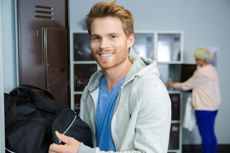 Young man in sports changing room royalty free stock image