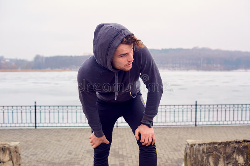 Young man in sportswear a park for sports royalty free stock image
