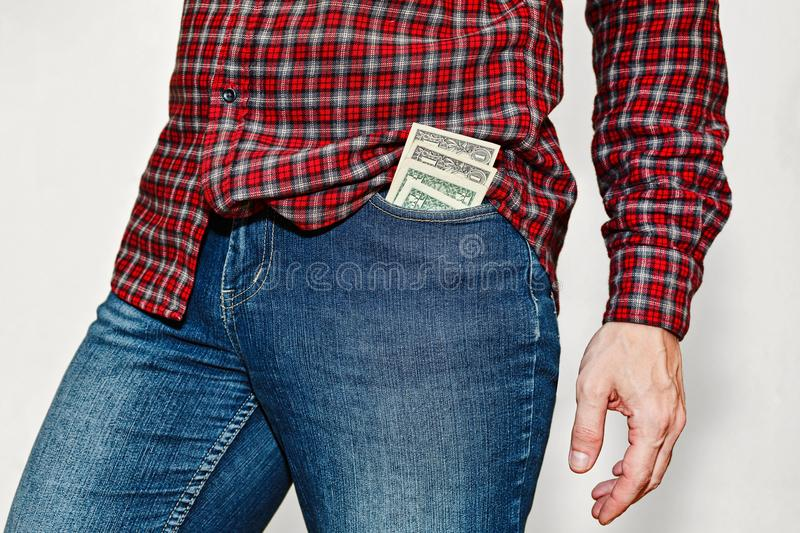 Young man with stack of dollars in pocket royalty free stock photos