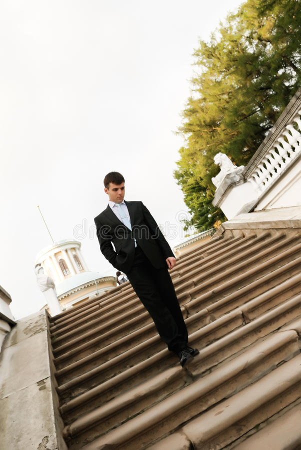 Young man on stairs stock photography