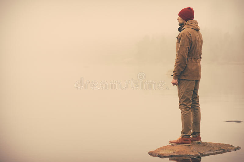 Young Man standing alone outdoor royalty free stock photos