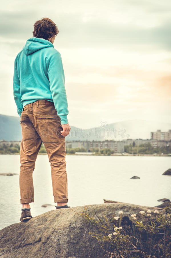 Young Man standing alone outdoor Travel Lifestyle stock images