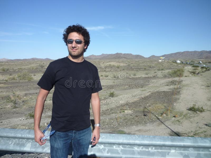 Young man in the desert stock images