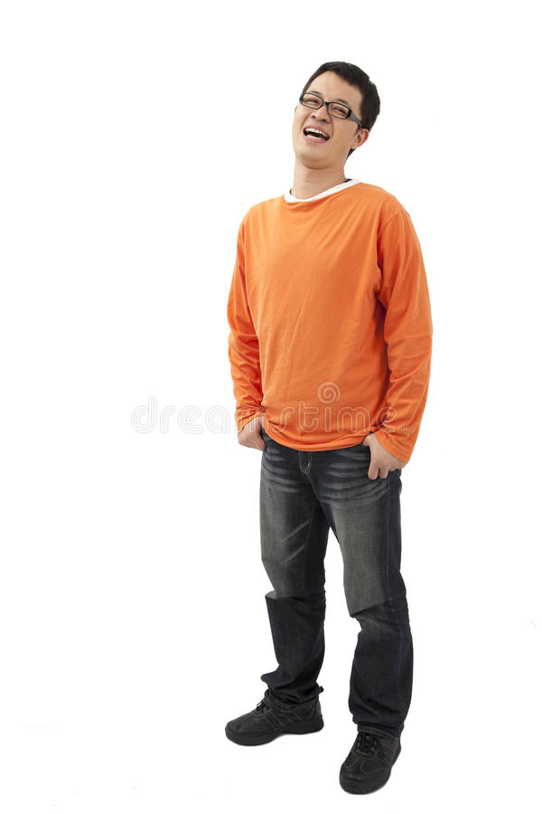 Young man standing with hands in pockets royalty free stock images