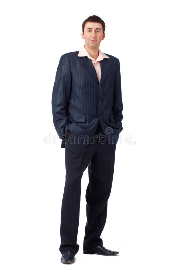 Download Young Man Standing With His Hands In Pockets. Stock Photo - Image: 19778170