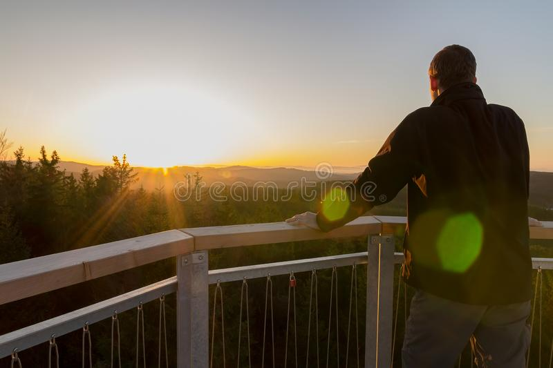 Young man standing on lookout Nebelstein, enjoy view to nature royalty free stock images