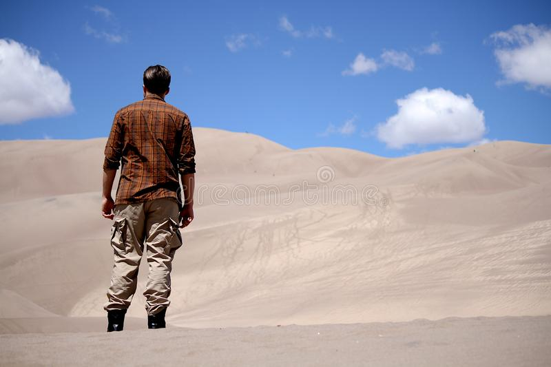 Young man standing in the Sand Dunes National Park Colorado royalty free stock photography