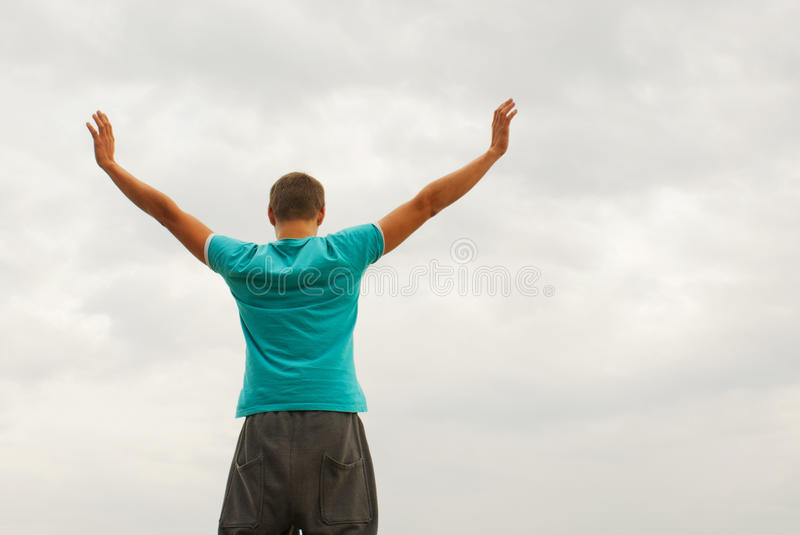 Download Young Man Staying With Raised Hands Stock Image - Image of emotional, human: 22136213