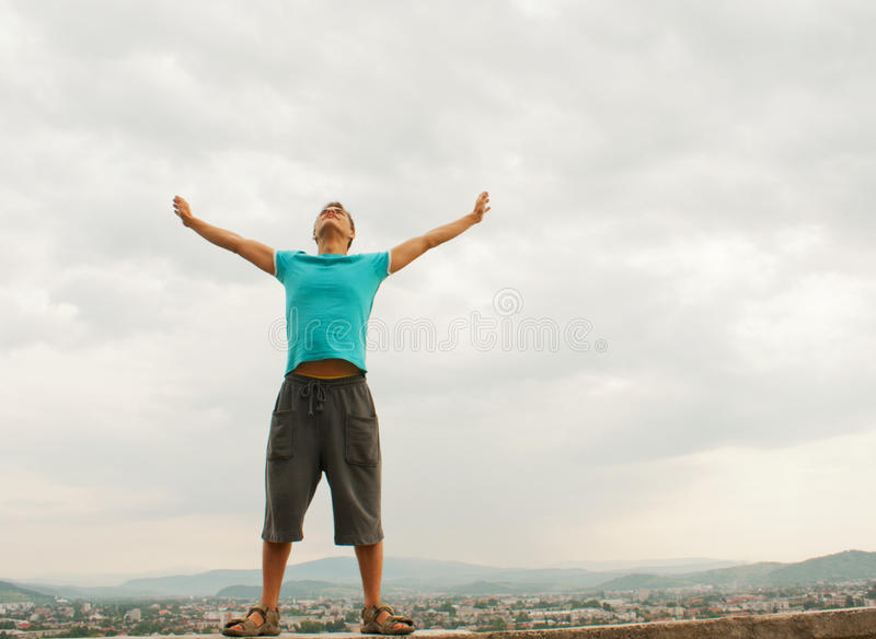 Download Young Man Staying With Raised Hands Stock Image - Image: 22136311