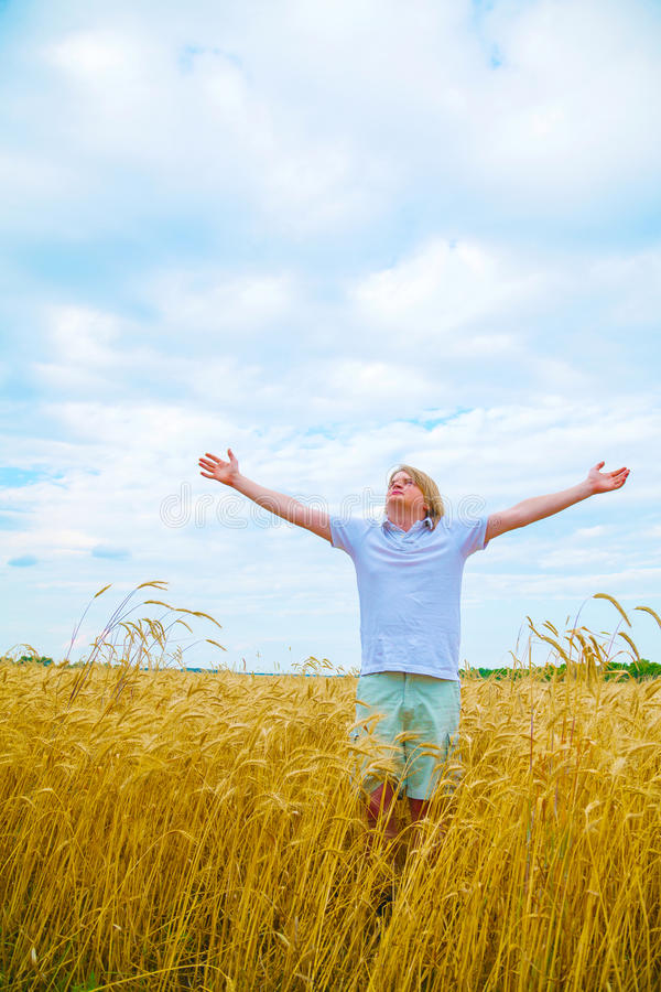 Download Young Man Staying With Raised Hands Stock Photo - Image of teen, pray: 29758024