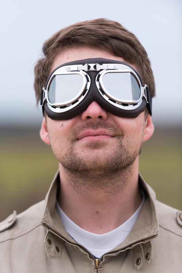 Young man with steampunk aviator goggles royalty free stock photos