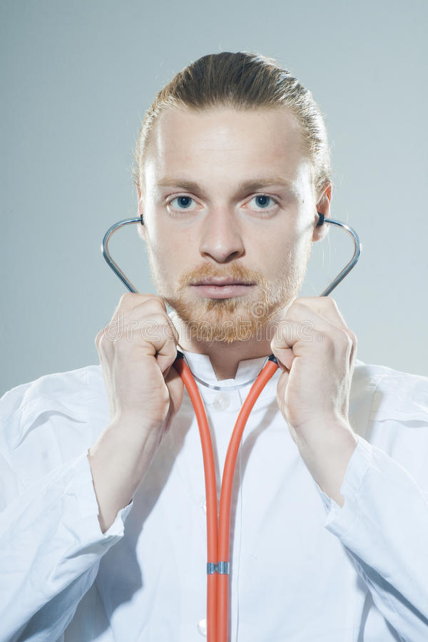 Download Young man with stethoscope stock photo. Image of earnings - 39501464