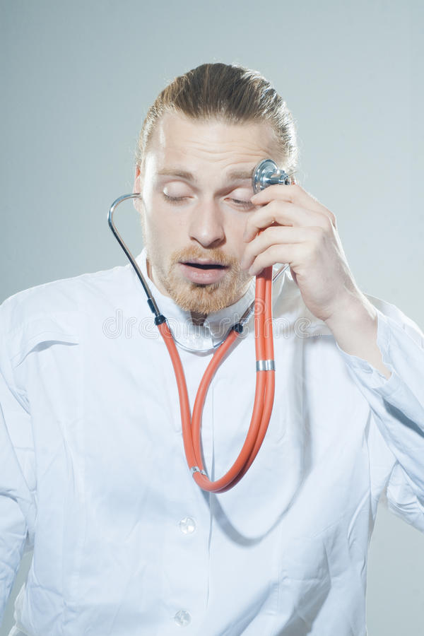 Download Young man with stethoscope stock image. Image of career - 39501519