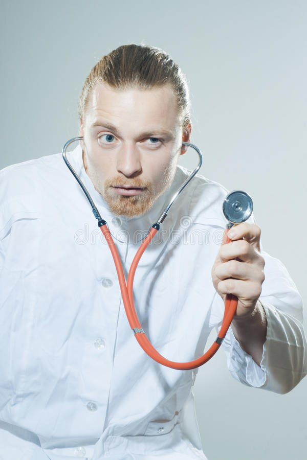Download Young man with stethoscope stock photo. Image of humor - 39501596