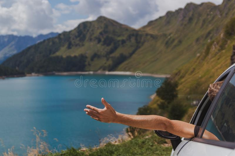 Young man stopped his car for enjoying the astonishing view and enjoy freedom stock images