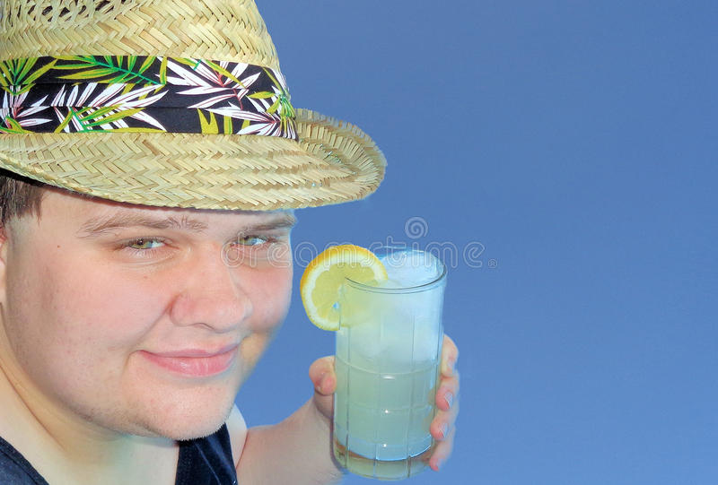 Young Man in a Straw Fedora Holding a Glass of Lemonade stock photography