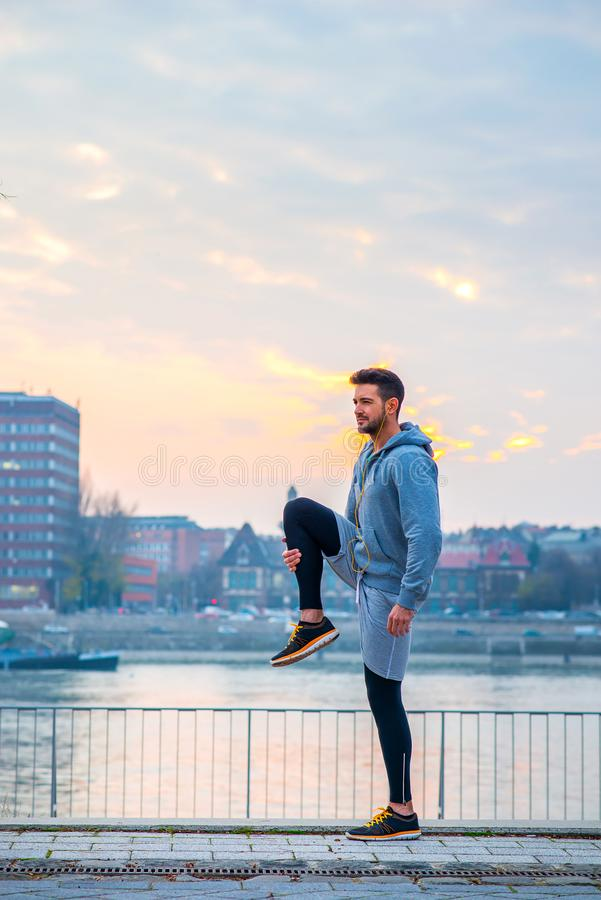 Young man stretching royalty free stock photography