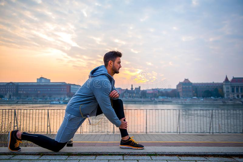 Young man stretching royalty free stock image