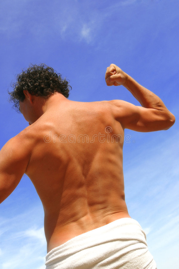 Young man stretching his arms stock images