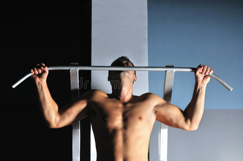 Download Young Man With Strong Arms Working Out In Gym Stock Photo - Image: 8064272