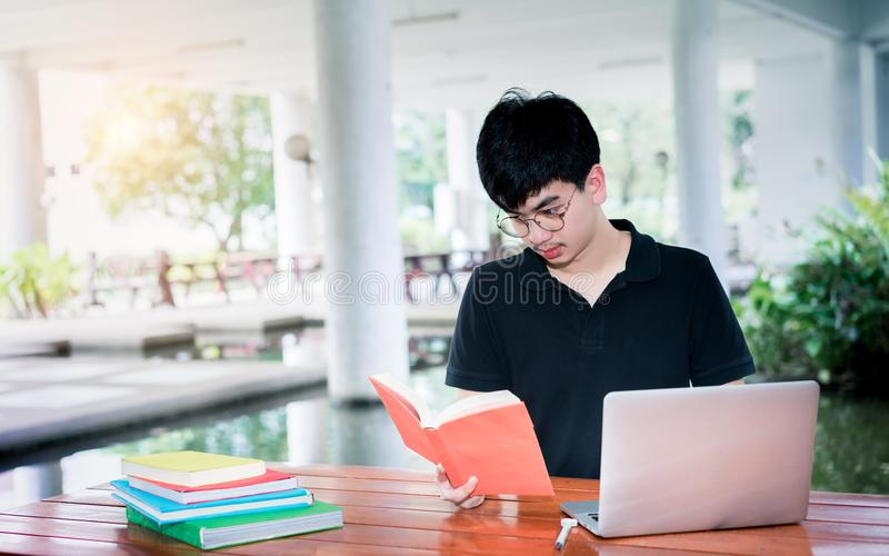 Young man student reading school book folder royalty free stock photo