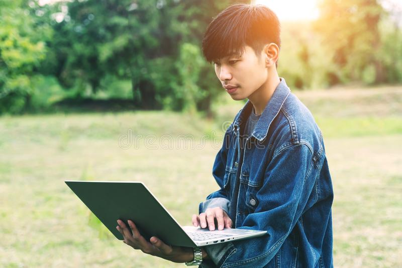 Young man using laptop during camping in the morning stock photos