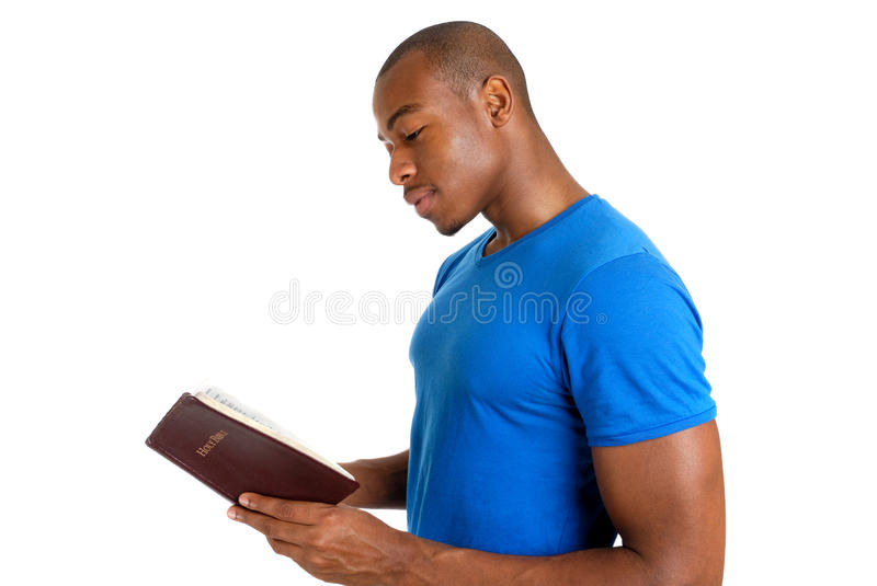 Young man studying the bible. This is an image of young man studying the bible stock images