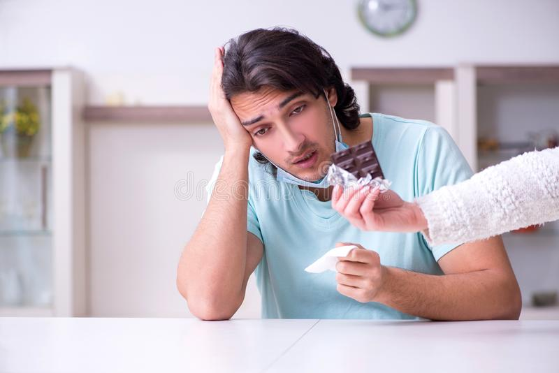 Young man suffering from allergy royalty free stock photos