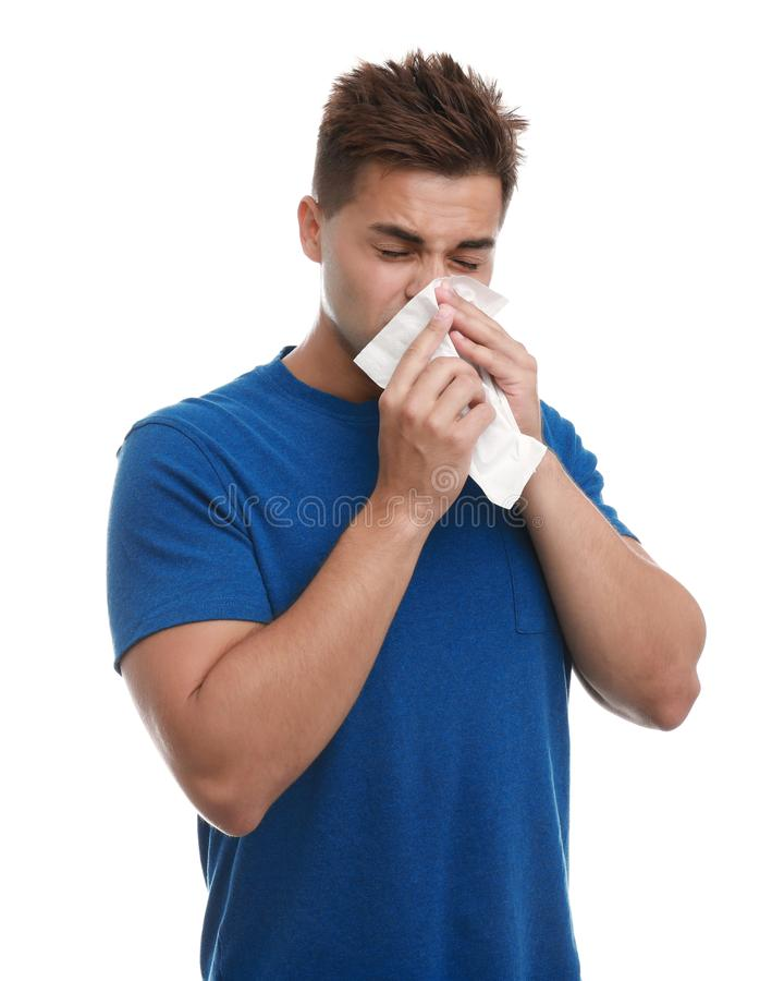 Young man suffering from allergy on white stock photo