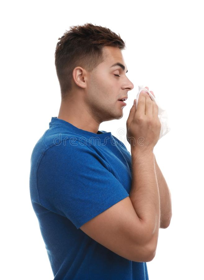 Young man suffering from allergy on white stock photography