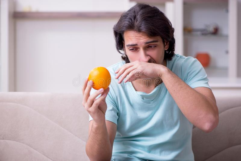 Young man suffering from allergy stock photography