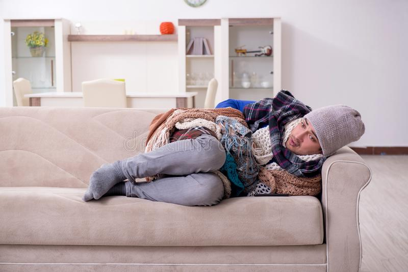 Young man suffering at home stock photography