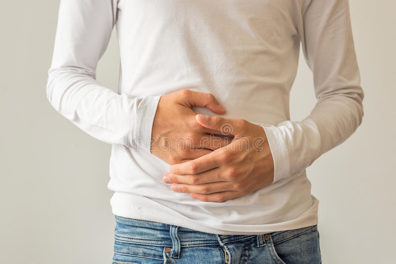 Young man suffering from stomach ache diarrhea, constipation, acid reflux, indigestion, nausea. Young man suffering from stomach ache, diarrhea, constipation royalty free stock images