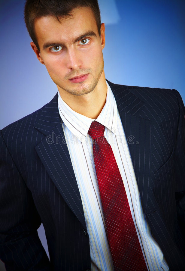 Young man in a suit royalty free stock images