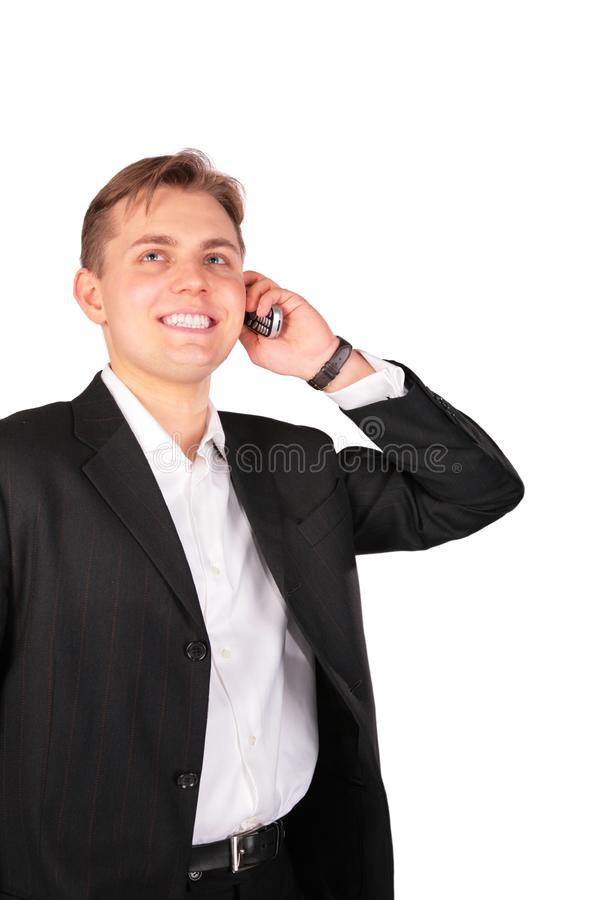 Young man in suit with cellphone stock images