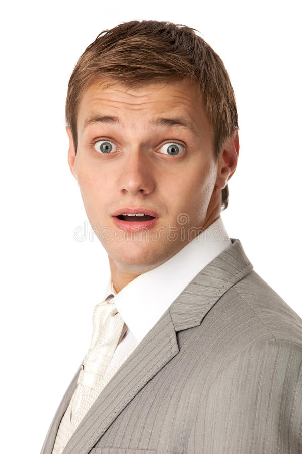 Young man in a suit looking very shocked stock photos