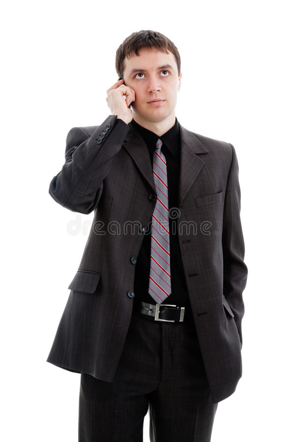 Download A Young Man In A Suit, Talking On The Phone. Stock Photo - Image: 19548128