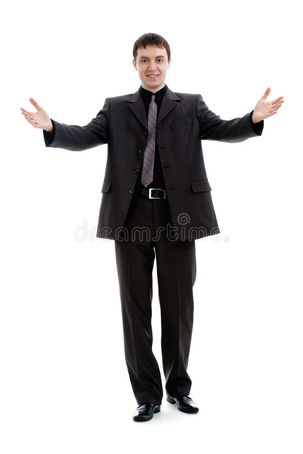 Download A Young Man In A Suit, Welcomes. Stock Photo - Image: 19548122