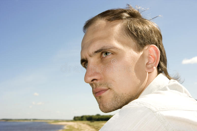 Download The Young Man In The Summer On River Bank Stock Images - Image: 11162634